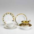 French porcelain twentyseven pieces include six old paris teacups and saucers in gold leaf with grapevine borders three limoges custard cups and saucers etc tallest 3 14