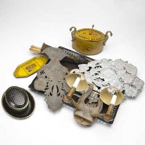 Punched tin and toleware lyreshaped wall sconce tray with three ladies match holder tea caddy three pressedpunched tin garden ornaments oval box and tray two small trays with french scenes c