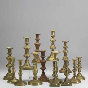 Brass candlesticks seven pairs in various shapes and styles tallest 10