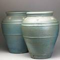 Garden pair of tall glazed terracotta oil jars with applied decoration 25 x 21 dia