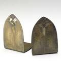 Roycroft pair of brass washed copper bookends decorated with trillium orb  cross mark 5 12