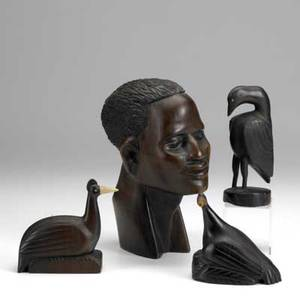 Four wood sculptures african or pacific islands bust of a man together with three birds 20th c tallest 13