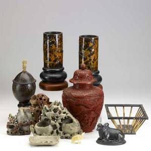 Asian grouping ten pieces include cinnabar ginger jar converted to lamp six pieces of carved soapstone or hardstone etc 19th20th c tallest 11 12