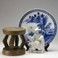 Asian etc blue and white imari charger painted with a landscape and mounted blanc de chine figure together with an tribal stool charger 18 dia