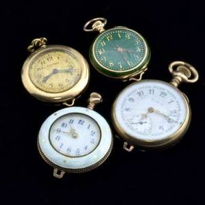 Four ladies pocket watches in gold and gf swiss green guilloche enamel with gold fleur de lys waltham gold face with keystone 14k yg case swiss gilded sterling case with white guilloche and gold