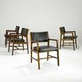 Edward wormley dunbar four sculpted walnut dining chairs with leather upholstery one with brass d tag 31 12 x 22 34 x 22