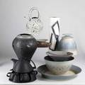 Contemporary craft pottery peter saenger black porcelain tea set and louis vaccaro cylindrical vase together with seven pieces by stephen fabrico including a black vase covered jar two bowls two s