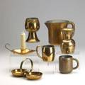 Chase copper seventeen pieces inclde two folding trays two goblets designed by gerth  gerth four coffee mugs three nut dishes designed by ruth gerth etc
