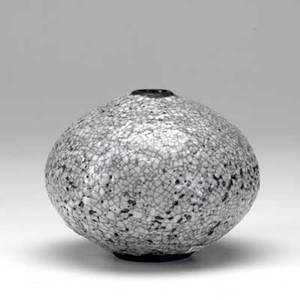 Otto heino squat vessel with small opening covered in a thick white crackled volcanic glaze marked 5