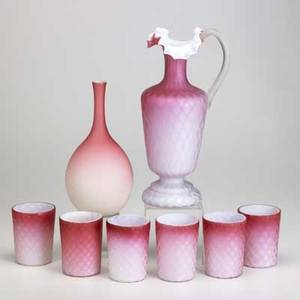 Satin glass grouping eight pieces 19th20th c quilted pitcher with six tumblers and a peachblowtype bud vase tallest 12