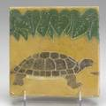 Grueby tile with turtle under leaves early 20th c unsigned 6 sq