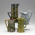 Pitcher grouping four pieces include french majolica minton jones  walley and tall faience decorated with writing all 19th20th c tallest 13