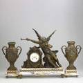 French figural clock set three pieces in bronzed white metal the clock depicting a horn blower with garniture ca 1900 20 34 x 19 x 7 14