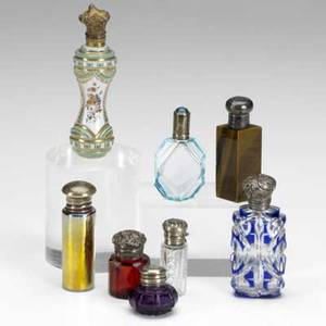 Perfume bottle grouping eight pieces include overlay glass gold iridescent cut glass colored glass with silver caps all 20th c tallest 4