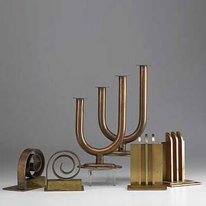 Walter von nessen chase two pairs of copper and brass bookends together with a pair of copper double candlesticks bookends stamped chase logo sticks inscribed prototype for chase by von nessen 26