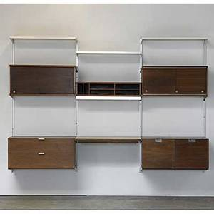 George nelson herman miller walnut comprehensive storage systems css with four vertical supports five cabinets one desktop and three enameled metal shelves herman miller metal tag 66 x 96 x