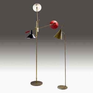 Lightolier two brass floor lamps one threearm with enameled metal and pierced shades with adjustable levers and single floor lamp with pierced brass shade and integrated handle single lamp 56 h