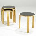 Style of alvar aalto nesting tables in laminate and birch plywood branded made in danmark 16 12 x 15 34 dia