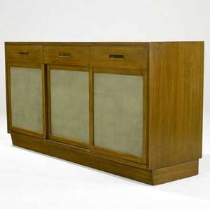 Edward wormley  dunbar walnut sideboard with three divided drawers and three leathercovered sliding doors enclosing interior drawers and shelves 33 34 x 61 12 x 18 14