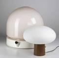 Modern lighting laurel table lamp with mushroom shade on wood base together with a stilnovo table lamp with belljar shaped rose glass shade both marked stilnovo 18 x 18 dia