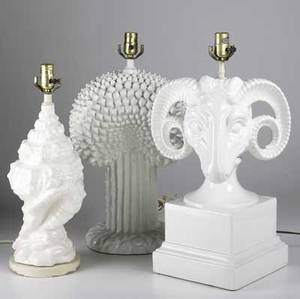 Lighting three figural white porcelain table lamps together with two shell shaped metal enameled lamps tallest 22 12