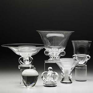 Steuben six pieces in clear crystal 20th c crown and apple paperweights footed compote with crown base large tulip vase trumpet vase and an urn each engraved steuben tallest 6 34