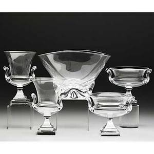 Steuben five pieces in clear crystal 20th c pair of urns with classically designed square bases pair of footed compotes with similarly treated bases and a large bowl with free form globular base