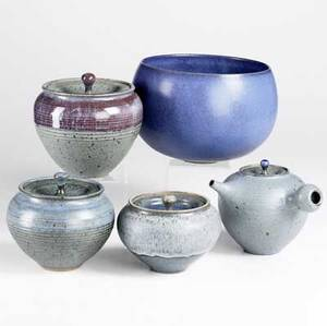 Stephen merritt five pieces of stoneware teapot three covered jars and a bowl with closedin rim most marked largest 6 x 9 x 9
