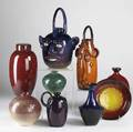 Jim spires nine pieces include two face jugs similar handled jug four vases ginger jar and bowl some dated and numbered each signed tallest 15 12