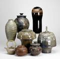Carl shanahan eight pieces of stoneware include five covered jars teapot and two vases all decorated in sgraffito dated 19982000 each signed tallest 16 x 6 12 dia