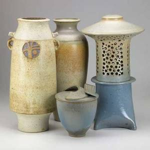 Carl shanahan four pieces of stoneware include two tall vases covered jar and a pierced lantern lamp each signed tallest 18 14 x 7 34 dia