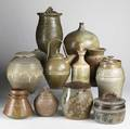 Contemporary studio pottery twelve items include pieces by peter knickerbocker warren mckenzie ron hand and others most signed tallest 16 12