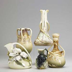 Riessner stellmacher  kessel ernst wahliss five porcelain amphora vases two small with relief floral and grape decoration together with three others of similar decoration amphora red r st k to