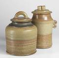 Val cushing two stoneware covered jars and pitcher 1986 each signed covered jars 13 x 9 x 8 13 x 9 x 9