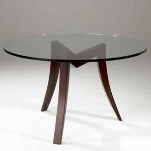 Dialogica cooke dining table with circular plate glass top over sculptural solid maple base in mahogany finish stamped dialogica 28 34 x 48 dia