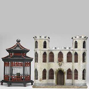 Two decorative bird cages one designed as a castle with turrets and cannons together with a pagodashaped hexagonal victorian bird cage 19th c larger 30 x 28 12 x 14 12