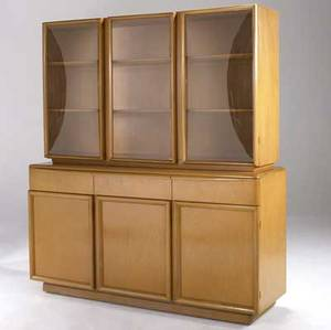 Heywood wakefield twopiece buffet in champagne finish the top with three convex glass doors each enclosing two adjustable shelves the base with three drawers over three doors enclosing one adjustab