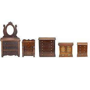 Five furniture miniatures empire with backsplash mirrored victorian chest two mahogany chests and edwardian chest with glass doors 19th20th c largest 18 x 11 x 31