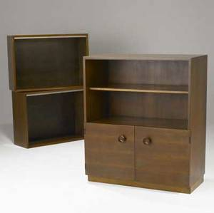 Gilbert rohde and george nelson  herman miller twodoor bookcase and two openface bookcases in walnut stenciled numbers on backsides 42 14 x 36 x 18 and 24 x 34 x 12