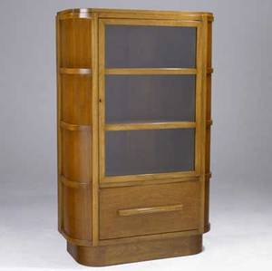 Donald deskey walnut bookcase with locking glass door enclosing three shelves over single drawer 1935 61 x 37 12 x 16 12