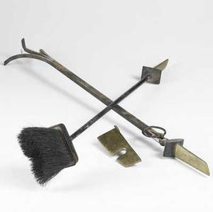 Donald deskey brass and enameled cast iron fireplace tools consisting of a poker broom and hanger