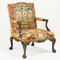 Chippendale style open armchair with carved frame and needlepoint upholstery 20th c 41 x 30 x 31
