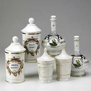 Four apothecary jars white porcelain with latin names together with two castelli decanters marked 667 and 674 19th20th c tallest 10 34