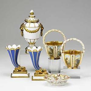 Six porcelain pieces pair of coalport baskets with handpainted panels pair of cornucopia vases kpm covered urn and reticulated basket with relief design 20th c tallest 9