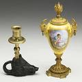 Sevres style covered urn dore trim goat head handles converts to candlestick 19th c together with boars head candlestick 19th c taller 9 12