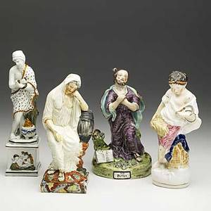 Four porcelain figures st peter snake charmer and two others 19th c tallest 10