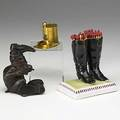 Three match holders monkey in boots hat in gilt metal and pair of porcelain boots 19th20th c tallest 4 14