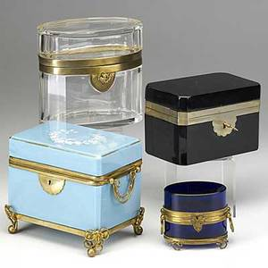 Four glass caskets blue opaline with enamel cobalt blue amethyst and clear glass all metal mounted 19th20th c largest 5 12 x 3 34 x 5