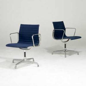Charles and ray eames for herman miller two aluminum group dining chairs with arms branded 33 12 x 23 x 22