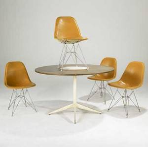 George nelson  charles eames for herman miller dining table and four chairs table in walnut with painted metal base eiffel tower chairs with vinyl upholstery table 29 12 x 48 dia